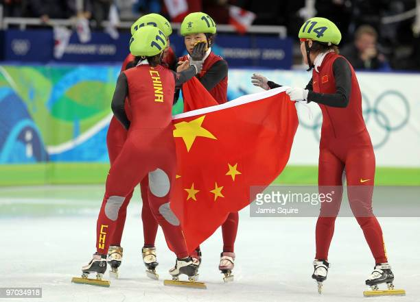 Sun Linlin Wang Meng Zhou Yang Zhang Hui and Wang Meng of Team China celebrate winning the gold medal in the Short Track Speed Skating Ladies' 3000m...