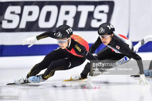 Sun Long of China competes against Kazuki Yoshinaga of Japan in the men's 500 meter semifinal during the ISU World Junior Short Track Championships...
