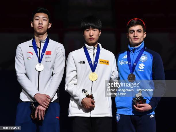 Sun Long of China Kim Tae Sung of Korea and Pietro Sighel of Italy stand on the podium with their medals after finishing in the top three spots of...