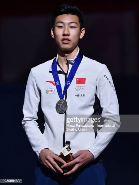 Sun Long of China poses with his silver medal after finishing second in the men's 500 metre final during the ISU World Junior Short Track...