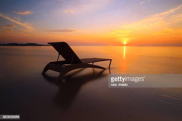 Sun lounger on the beach at sunrise, Nusa Dua, Bali