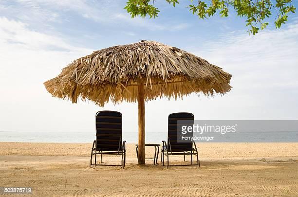 Sun loungers and beach umbrella on the beach, Jamaica, Caribbean