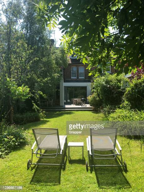 sun loungers in a garden, london, england, uk - chair stock pictures, royalty-free photos & images
