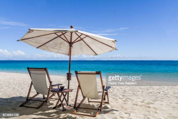 sun loungers - outdoor chair stock pictures, royalty-free photos & images