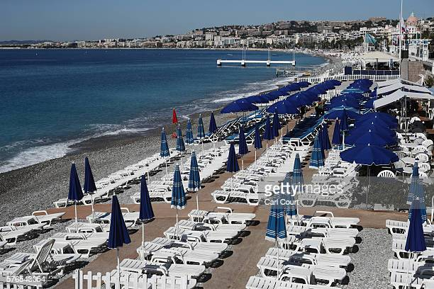 Sun loungers sit empty on the beach on the Promenade des Anglais on July 16 2016 in Nice France Five people believed to be linked to the man who...