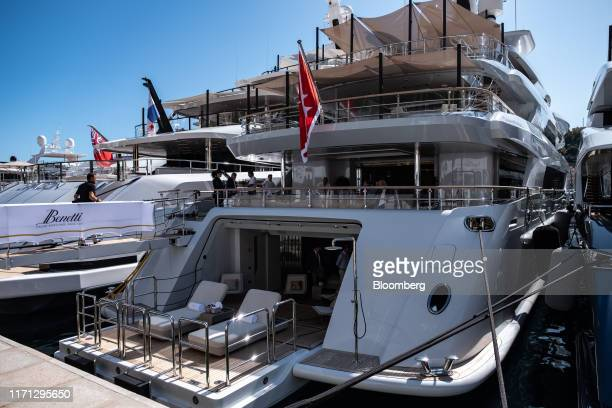 Sun loungers sit on the stern deck of luxury superyacht Metis manufactured by Azimut Benetti SpA as it sits moored during the Monaco Yacht Show in...