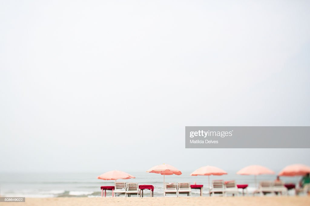 Sun loungers with umbrellas on a Goa beach. India : Stock Photo