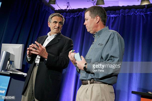 Sun Microsystems Chairman and CEO Scott McNealy listens as Charlie Feld, EVP Portfolio Management of EDS addressed a crowd of reporters and analysts...
