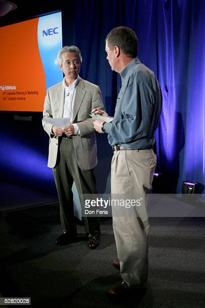 Sun Microsystems Chairman and CEO Scott McNealy talks with Yuji Ichimura, VP Corporate Planning and Marketing for NEC Solutions America before a...