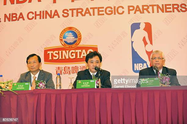 Sun Mingbo President of Tsingtao Brewery Jin Zhiguo Chairman of Tsingtao Brewery and NBA Commissioner David Stern annouces a partership between the...