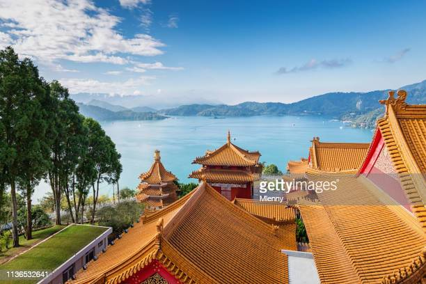 sun moon lake view temple rooftops taiwan - taiwan stock pictures, royalty-free photos & images