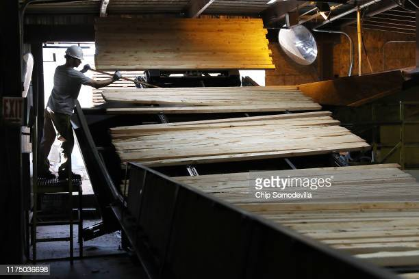 Sun Mountain Lumber employees work the day shift cutting sorting and processing Douglas fir at the saw mill September 12 2019 in Deer Lodge Montana...