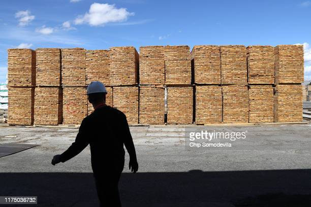 Sun Mountain Lumber Superintendent Nelson Bohrer walks past stacks of cut lumber at the saw mill September 12 2019 in Deer Lodge Montana According to...