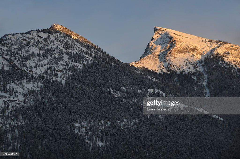 Sun on snowy peak : Stock Photo