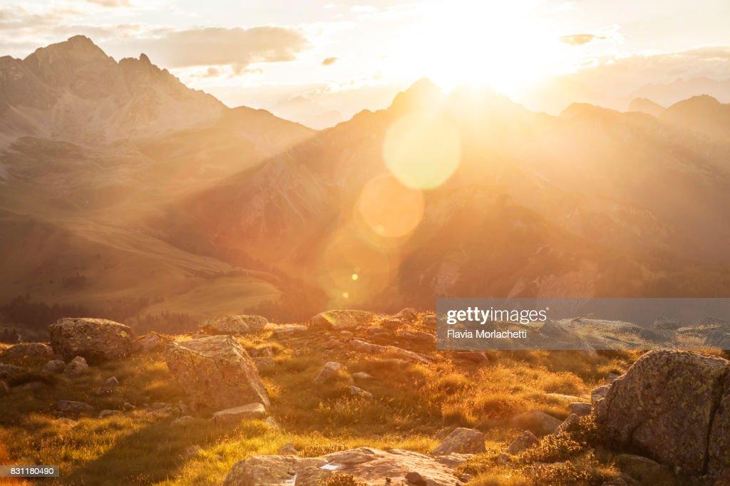Sun over Dolomites mountains : Stock Photo