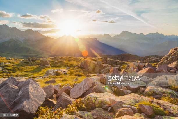 Sun over Dolomites mountains