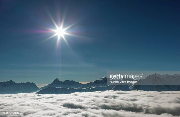 Sun over fog in the Swiss Alps.