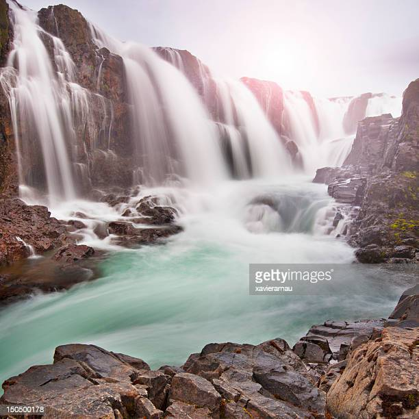 Sun over Kolufossar waterfall