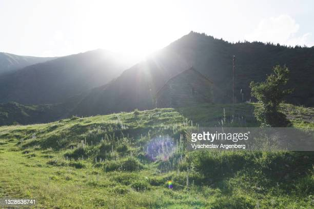 sun over mountains, caucasus mountains, georgia - argenberg stock pictures, royalty-free photos & images