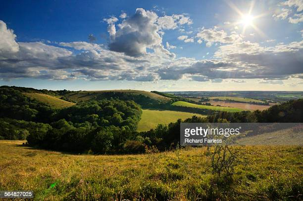 sun over old winchester hill - winchester hampshire stock photos and pictures