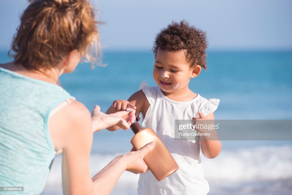 Sun protection lotion for baby healthy skin. : Stock Photo