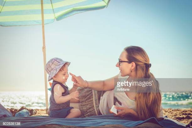 sun protection - uv protection stock pictures, royalty-free photos & images