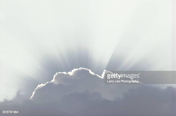 Sun Rays Radiate Around Cumulus Clouds