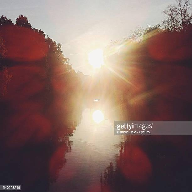 sun reflecting in water canal during sunset - danielle reid stock pictures, royalty-free photos & images