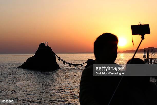 Sun rise between the 'MeotoIwa' or couple rocks and over the sea ahead of the Oshimenawahari ceremony at Futami Okitama Shrine on May 5 2016 in Ise...