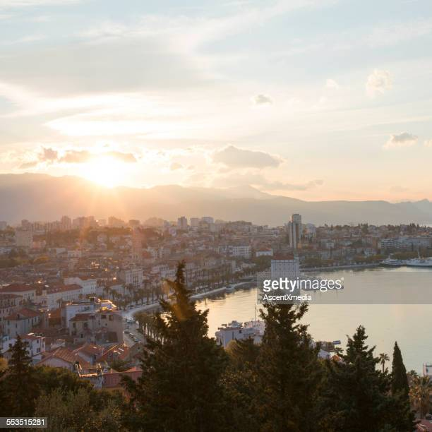 Sun rises above old town and harbour, Split