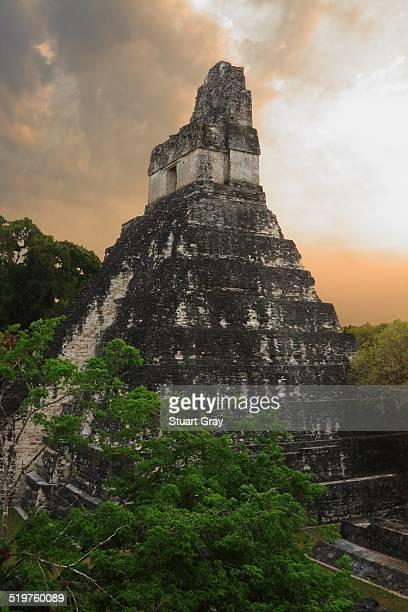 Sun rises behind Mayan Temple, Tikal, Guatemala