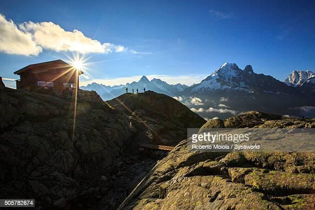 sun rises on refuge of lac de cheserys france - quebra ventos imagens e fotografias de stock