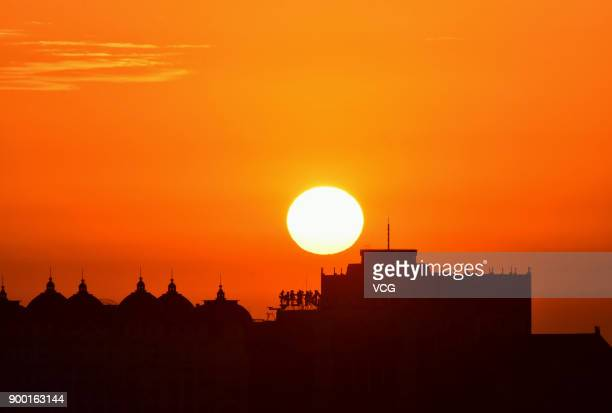 Sun rises over Beijing on New Year's Day on January 1 2018 in Beijing China