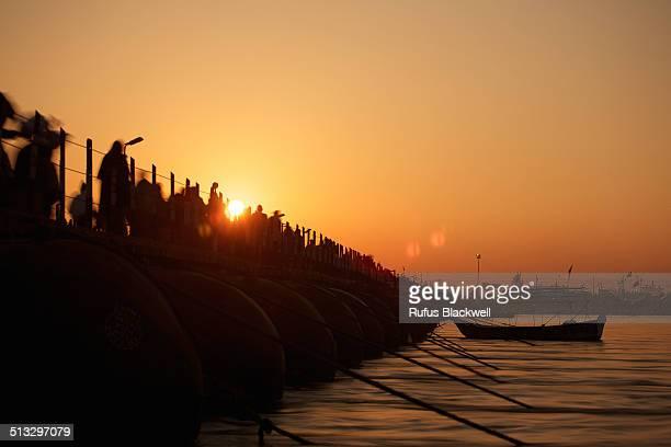 sun rises over floating bridge - kumbh mela stock pictures, royalty-free photos & images