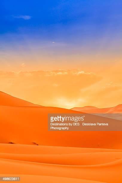 Sun rising in the desert