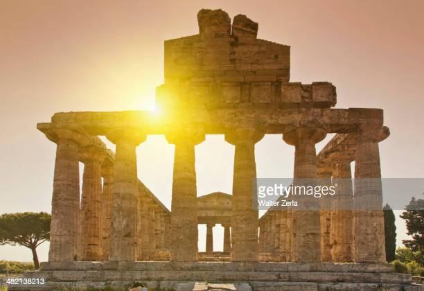 Sun rising over ancient ruins, Paestum, Campania, Italy