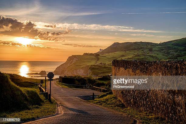 sun rising over cantabrian coastline