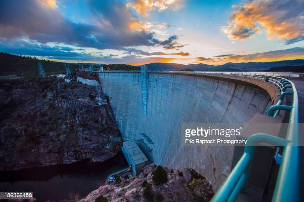 Sun rising over dam, Daggett, Utah, United States