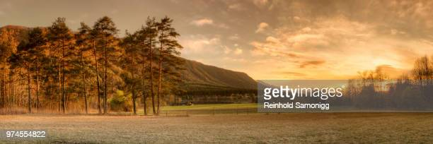 sun rising over hill, carinthia, austria - carinthia stock pictures, royalty-free photos & images