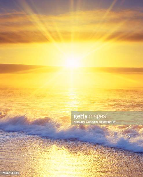 Sun rising over sea