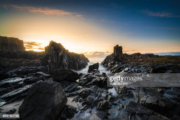 Sun rising over the rocks, coastal sea scape