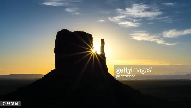 Sun rising over West Mitten Butte, Monument Valley, Arizona, America, USA
