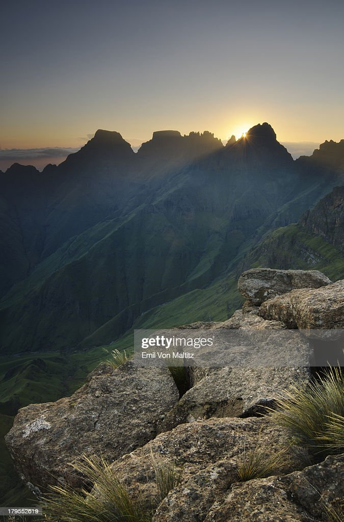 Sun rising through Mountain Paks : Stock Photo