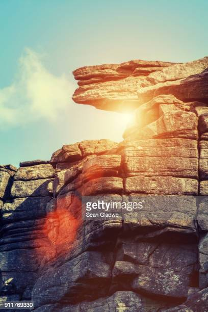 sun rock - rock overhang stock photos and pictures
