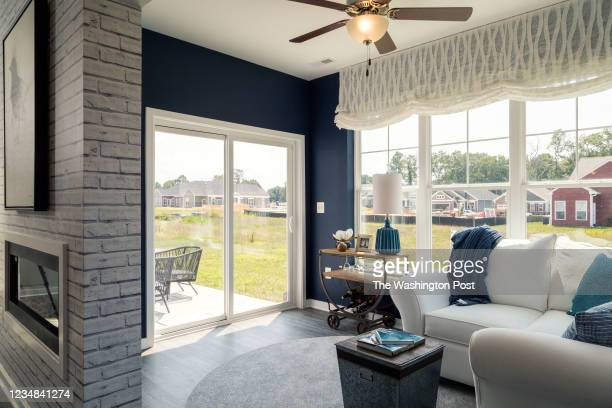 Sun Room with Two Way Fireplace in the Waverly Model Home at Hawthorne Greene on August 10, 2021 in La Plata Maryland.