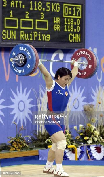 Sun Ruiping of China suceesfully lifts 1185 kg weight in snatch section of women 75 kg weightlifting competition at 14th Asian Games in Busan 07...