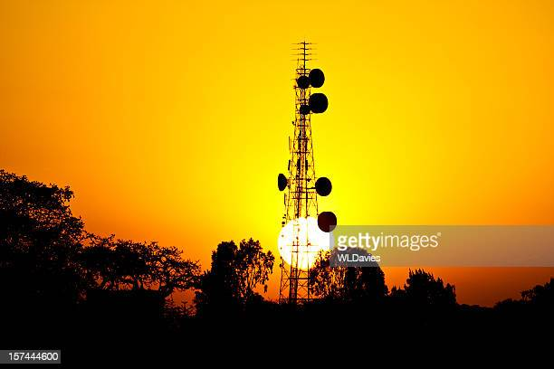 Sun sets behind African telecoms tower