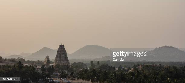 sun sets in hampi on a hazy evening. - lord krishna stock photos and pictures