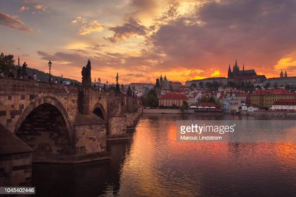 sun sets in prague - vltava river stock photos and pictures