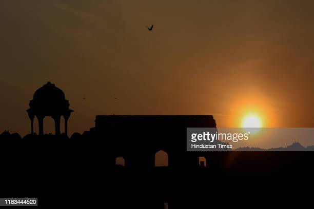 Sun sets in the backdrop of Purana Qila on November 19 2019 in New Delhi India Archaeological Survey of India is celebrating Heritage Week from...